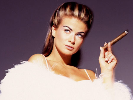Carmen Electra smoking a cigar