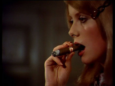 Catherine Deneuve smoking a cigar