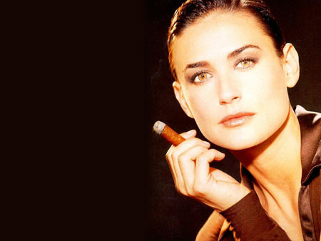 Demi Moore smoking a cigar