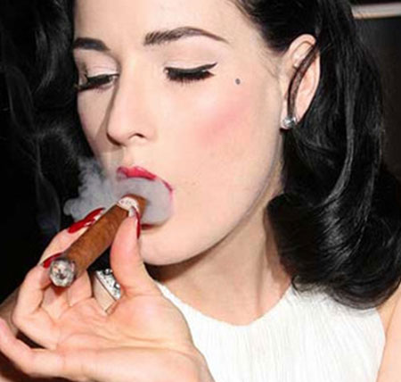 Dita Von Teese smoking a cigar