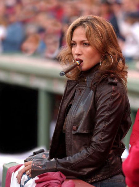 Jennifer Lopez smoking a cigar